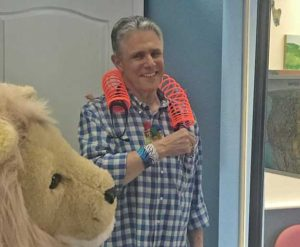 Dr-Ted-Meyer-With-Lion-In-Foreground